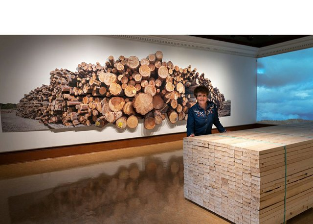"""Fern Helfand poses with """"Timber, Lumber, Wood, Home,"""" 2021 (courtesy of artist)"""