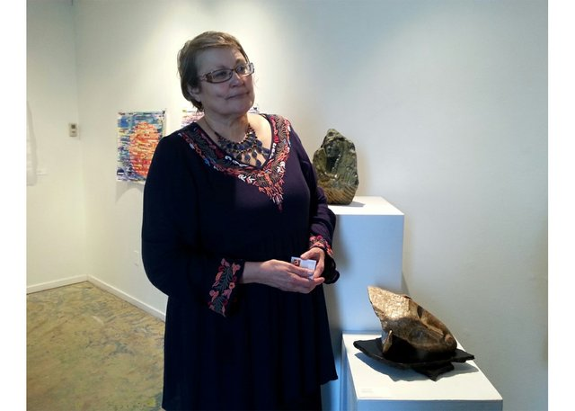 Jacqueline Fiala with her sculptures at CARFAC's New Voices exhibition in 2017. (courtesy Marlena Wyman)