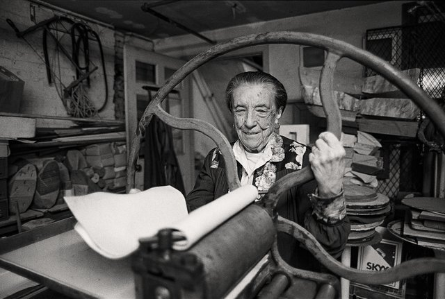 Louise Bourgeois at the printing press in the lower level of her home and studio on 20th Street