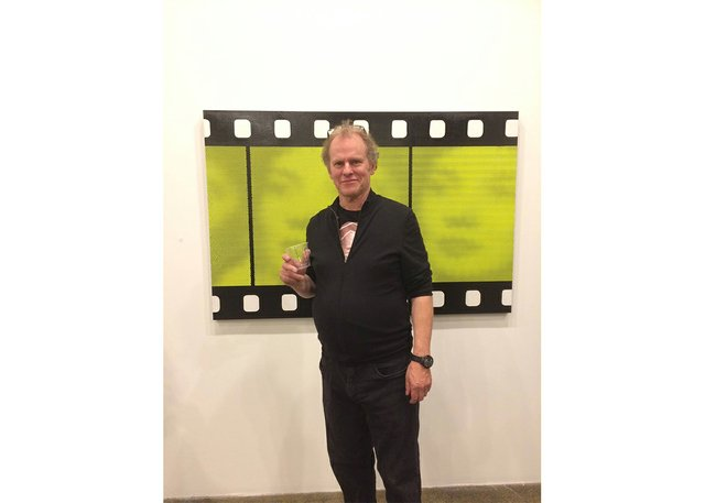 Chris Cran poses with his work. (courtesy of artist)