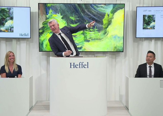 Robert Heffel at the auctioneer's podium for a live online sale on June 23, 2021. (courtesy Heffel)