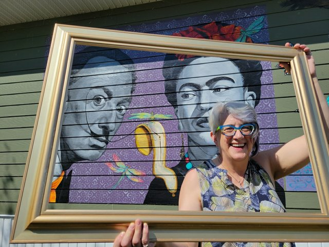 Gossamer Treasures owner Lois Hannam in front of her gallery in Wabamun, Alta. (photo by Sharon Samartino)