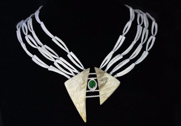 Tania Larsson's neckpiece is made from jade, silver, muskox horn, dentalium shells and antique French beads. (courtesy of artist)