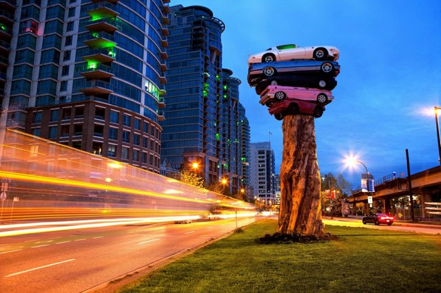 """Marcus Bowcott and Helene Aspinall, """"Trans Am Totem,"""" an installation for the 2015 Vancouver Biennale (photo by Robert Earnest)"""