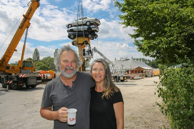"""Marcus Bowcott and Helene Aspinall in front of another temporary sculpture, """"Apparatus for Divining Capital"""" in 2017 at the Tollwood festival in Munich, Germany. (photo by Bernd Wackerbauer)"""