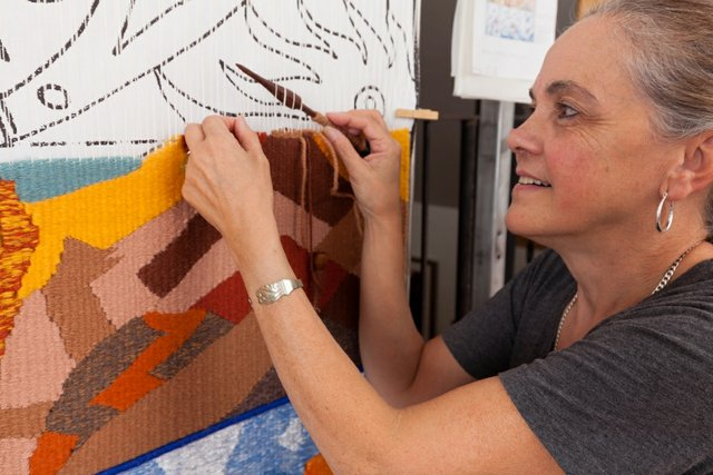 Carolina Sanchez de Bustamante weaves a 3D tapestry in her home studio in happier times. (courtesy the artist, photo by Yuri Akuney)