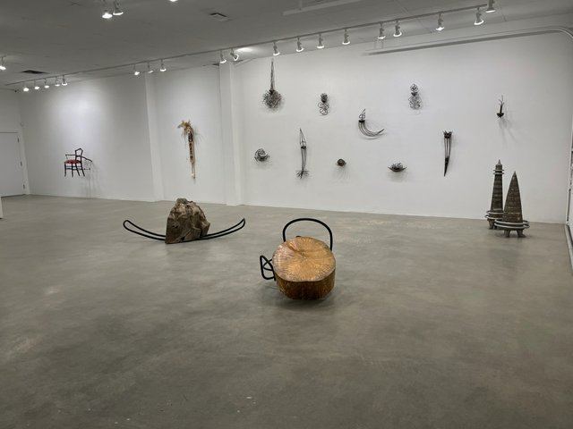 """Installation view of work by Walter May (foreground), Katie Ohe (right wall), Ron Kanashiro (middle wall) and Laura Vickerson (left wall) in """"Shaping Calgary,"""" 2021"""