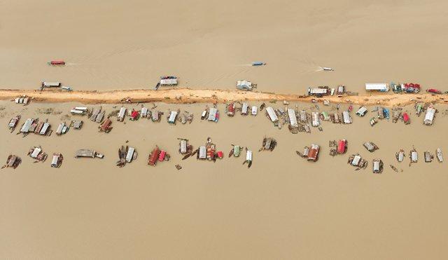 "David Burdeny ""Floating Village, Tonle Sap Lake, Cambodia"""