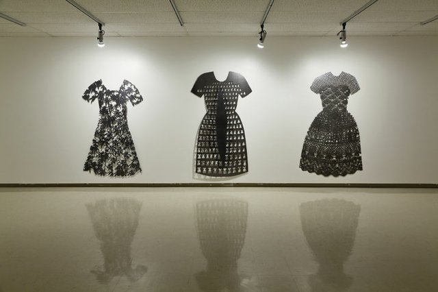 """(l to r) Lace Dress, 1995, plasma-cut, cold-rolled steel. Small Dresses, 1994, plasma-cut cold-rolled steel, Collection of the Canada Council Art Bank. Orchid Dress, 1993, plasma-cut cold-rolled steel"""