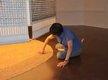"Amy Loewan installing wheat under ""Lantern."""