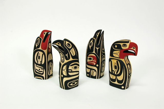 """Basswood Sculptures with acrylic paint, Eagle design, Raven design, Raven design, Eagle design."""