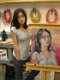 Germaine Koh poses with a version of her ongoing self-portrait in 2006 at the Kelowna Art Gallery.