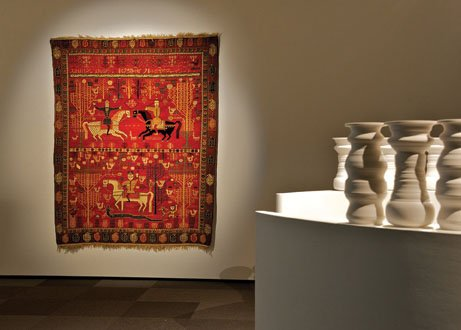 """Shirvan pictorial carpet"" (1882-1883) with a partial view of Greg Payce's ""Albedo"""
