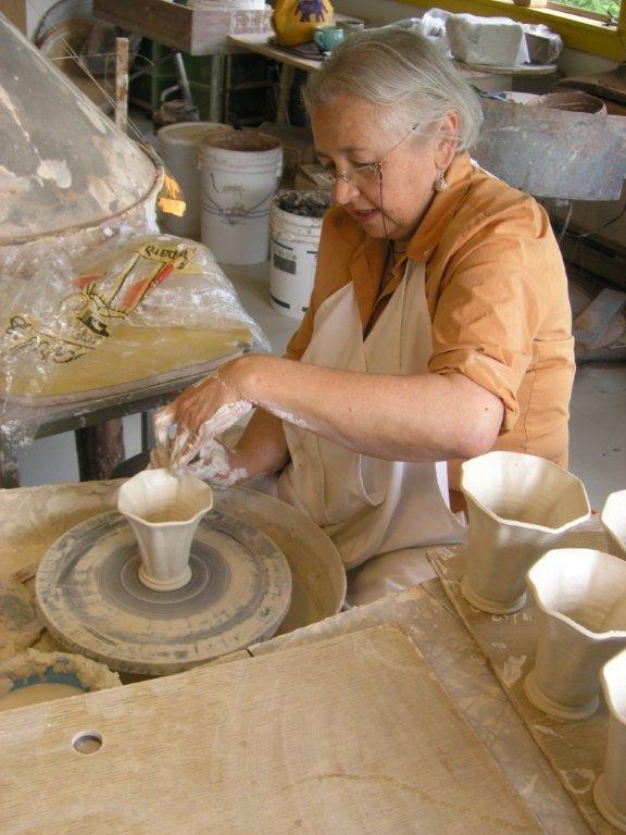 """Quadra Island potter, Martha James, making her famous mugs."""