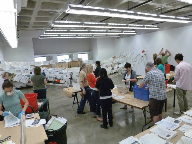 """""""After the Calgary flood, Stride's volunteers set documents and other material out to dry as other volunteers worked to repair basement walls"""""""