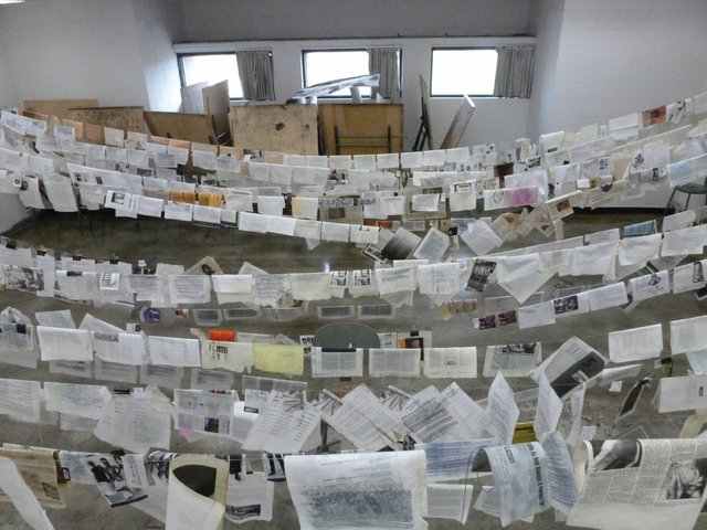 """After the Calgary flood, Stride's volunteers set documents and other material out to dry as other volunteers worked to repair basement walls"""