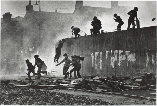"""Catholic youth escaping a CS gas assault in the Bogside, Londonderry"""