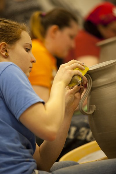 VIU Visual Art student Lucy Bonar works on a project in a ceramics class.
