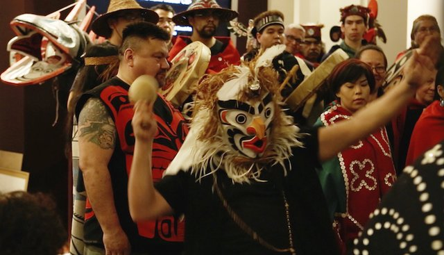"""Beau Dick, """"Atlakima Grouse Mask,"""" being danced at the exhibition opening"""
