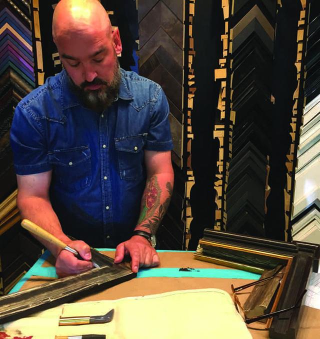 Jarvis Hall works on a frame.