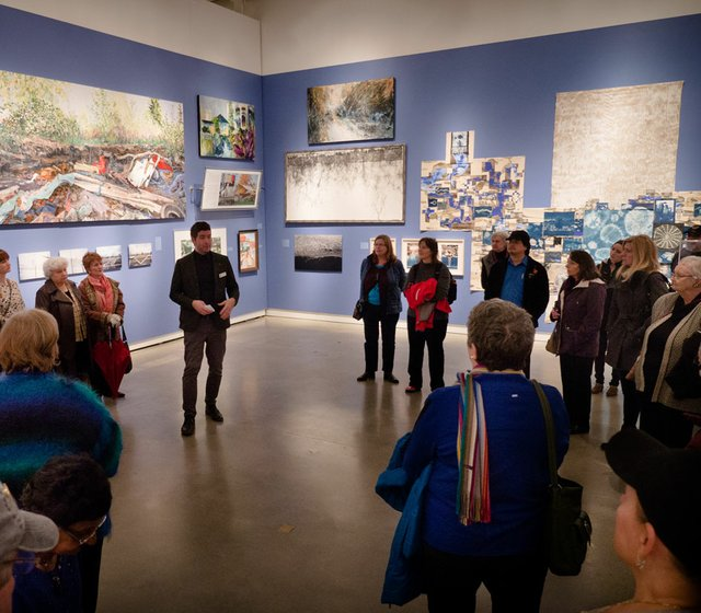 Curator Jordan Strom leads an exhibition tour.