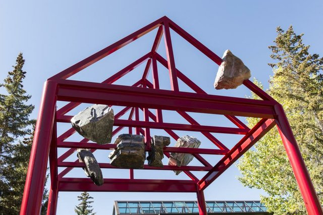 "Tyler Los-Jones, installation view of ""held above our heads in stone"" (2015). Fiberglass, foam, paint, glitter, dimensions variable. Commissioned by Walter Phillips Gallery at The Banff Centre."