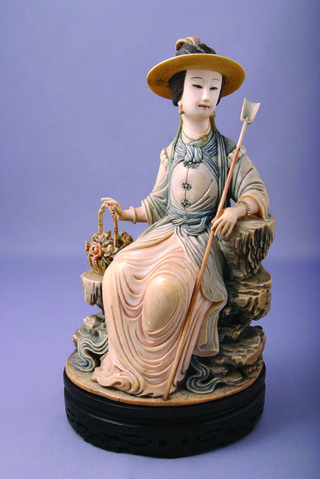 "Xiang Fei holding a basket of flowers, Qing dynasty, Qianlong period, late 18th century, ivory with stained colours, 8"" tall"