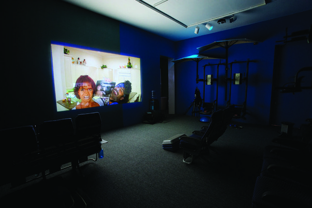 "Lizzie Fitch/Ryan Trecartin, ""Auto View"", 2011, built around: Ryan Trecartin, Sibling Topics (section a), 2009, HD video, unique sculptural theatre, installation view"