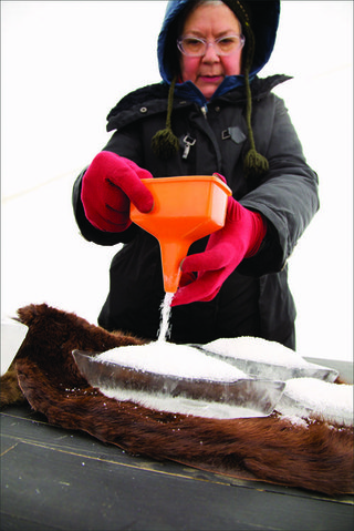 Elvira Finnigan pours salt on ice boats last year for Salt Trade at the RAW:almond pop-up restaurant on the Red River.