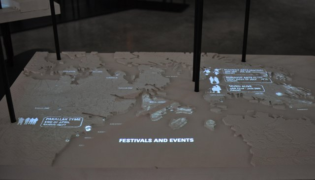 """Arctic Adaptations: Nunavut at 15,"" organized and curated by Lateral Office, tour presented and coordinated by the Winnipeg Art Gallery, 2014, installation detail of Nunavut art festival demographics (diorama with animated digital projection)"