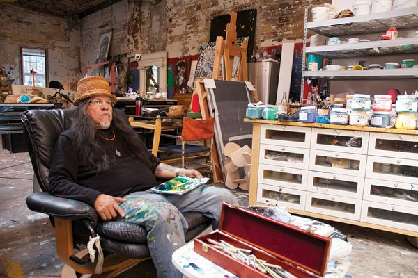Lawrence Paul Yuxweluptun in his studio (photo by Ken Mayer)