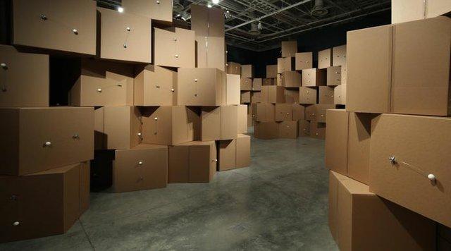 """Zimoun, """"370 prepared dc-motors, cotton balls, cardboard boxes, 71x71x71cm,"""" 2014"""