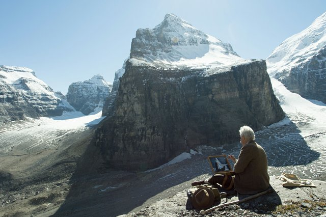 Ben Low as Lawren Harris painting Mt. LeFroy, Alberta