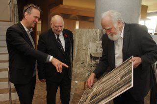 L-R Reid Shier (Presentation House Gallery), Rainer Müller (PARC), and Uno Langmann (Collector) view excerpts from a Presentation House exhibit following a $250,000 donation from PARC to PHG's new Polygon Gallery