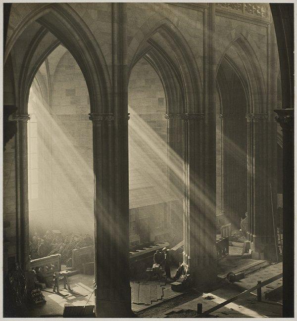 "Josef Sudek, ""Workers Inside St. Vitus Cathedral, Prague. Shafts of Light Illuminate the Space,"" 1924-28"