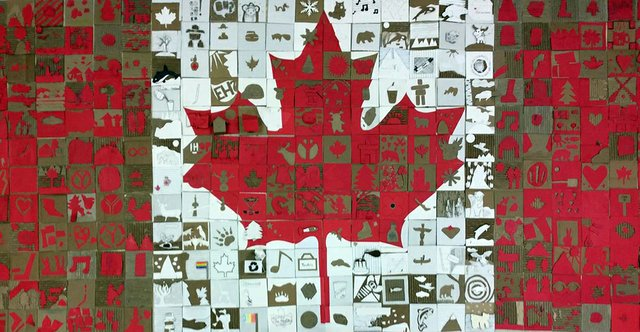 Cardboard Canadian flag made by art students at Will F. Davidson Elementary, Mary Jane Shannon Elementary, and Guildford Park Secondary schools.