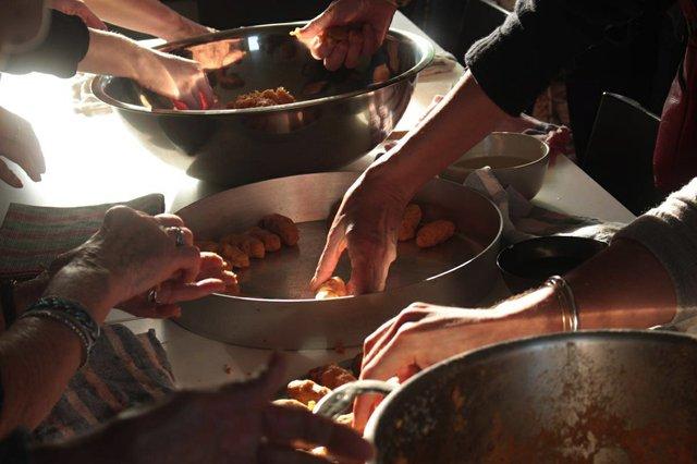 Derya Akay and women elders cook at the Burrard Marina Field House. Photograph Michelle Martin.